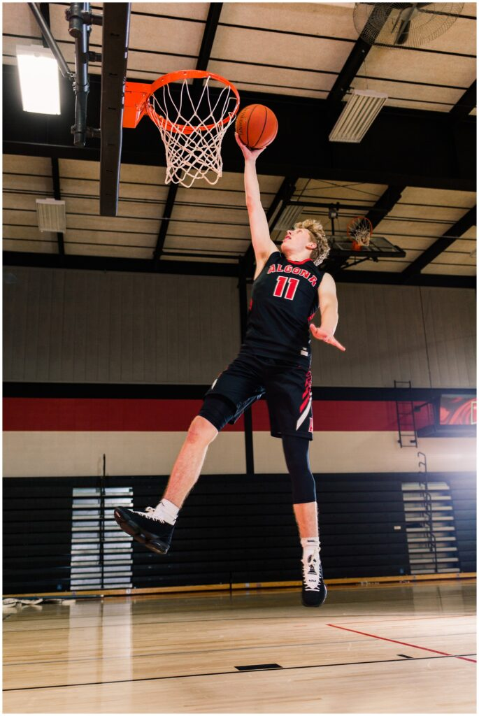 Senior boy shooting a basketball in the Algona High School gym | Iowa Senior Photographer | CB Studio
