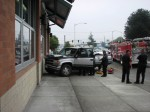 Medics tend to the driver of the truck that drove into the wall of the Broadway Walgreen's