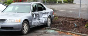 On the right is the pole the suspect reportedly tried to use on the victim before running him over and smashing into this car.