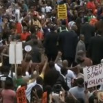 Hundreds march in Ferguson to protest police shooting