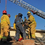 Firefighters used dish soap to rescue stuck burglar from chimney.