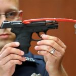 SMH: Some Azzhole brought The Gun George Zimmerman Used To Kill Trayvon Martin for $120,000