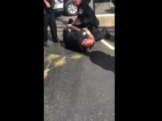 Dekalb IL Cop Under investigation after video show officer choking man.
