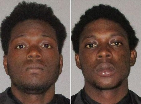 Two men arrested for pointing guns at a McDonald's cashier over cold burgers.
