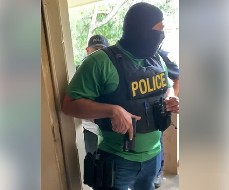 Viral footage posted to Facebook shows a Opa-locka police officer storming into an apartment without a warrant.