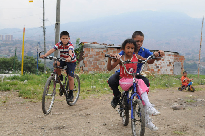 Children ride bikes near their homes on a toxic landfill known as El Morro in a poor neighborhood in Medellin, Colombia.