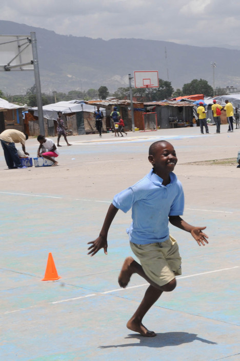 A boy participates in organized games at Carrefour Aviation, a tent camp housing 50,000 people who were displaced by the 7.3 magnitude earthquake on 12 January in Haiti.