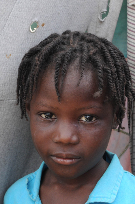 A displaced Haitian girl after the 2010 Haiti earthquake in Carrefour Aviation.