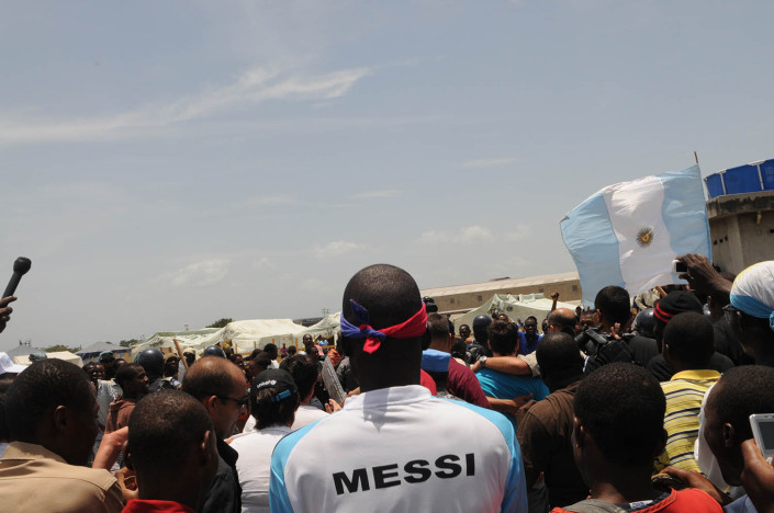 A man wears a t-shirt bearing the name of UNICEF Goodwill Ambassador, footballer Lionel 'Leo' Messi in Port-au-Prince, Haiti.