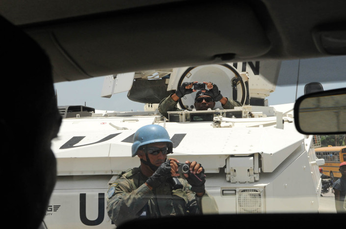 Peacekeepers with the United Nations Stabilization Mission in Haiti (MINUSTAH) photograph the arrival of UNICEF Goodwill Ambassador Lionel 'Leo' Messi at Carrefour Aviation in Port-au-Prince, Haiti.