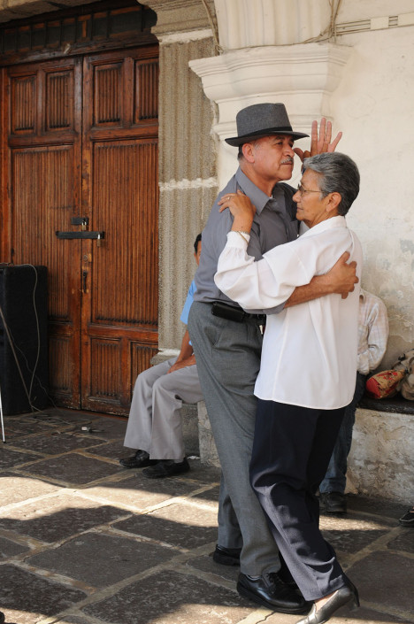 A couple dances in a plaza in Antigua, Guatemala.