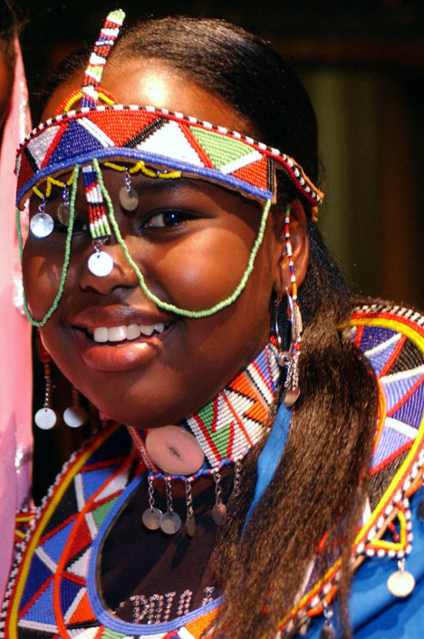Kenyan child delegate in indigenous dress.