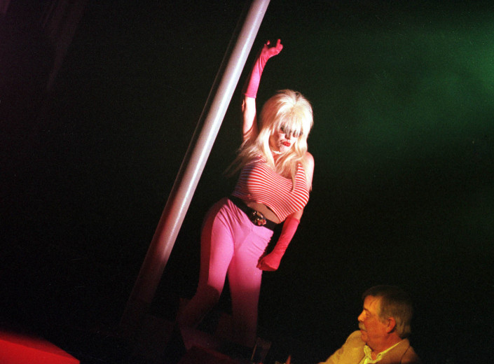 Female impersonator entertains a reluctant customer at the Queen Mary Nightclub