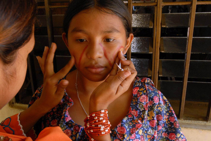 Indigenous Wayuu adolescent prepares for dance.