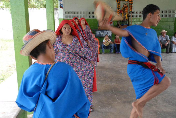 Adolescents participate in a Wayuu traditional dance in a community center in Paraguaipoa, Venezuela.
