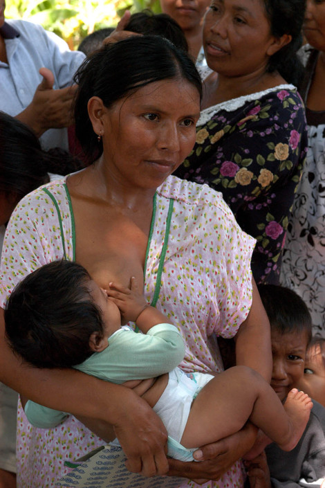An indigenous Wayuu woman breastfeeds her infant as she waits in line to have her seven children vaccinated at an immunization drive in Maracaibo, Venezuela.