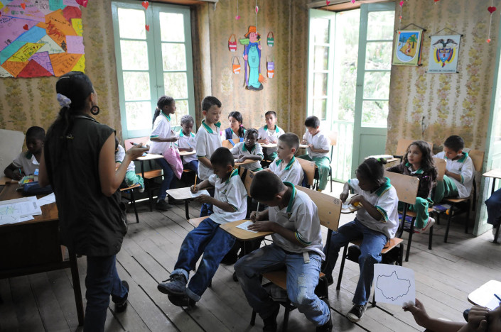 Second-grade students study geography in a neighborhood in Medillin, Colombia.