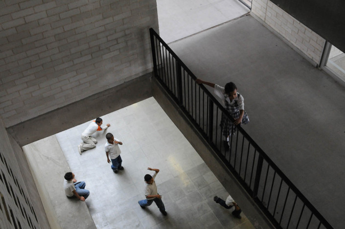 Children play in the hallways of their elementary school in Medellin, Colombia.