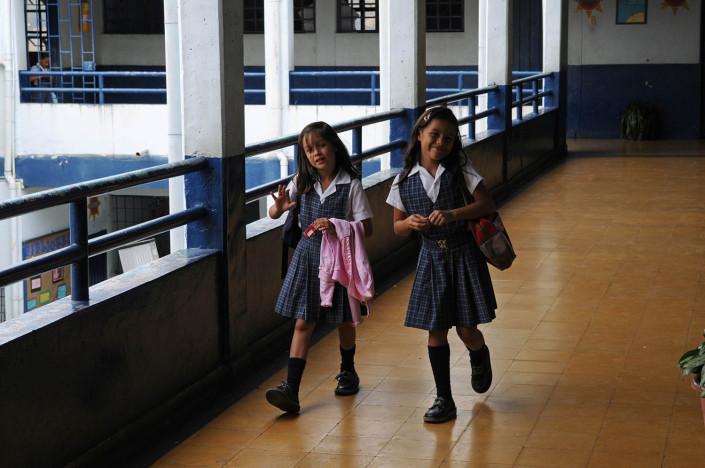 Girls walk through the hallways of a school in Medellín, Colombia.