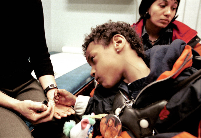 Dominick Reyes, 5, who has Cerebral Palsy, sits in front of his tired mom during a visit with the doctor.