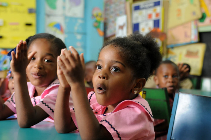 A girl recites the alphabet with her class at the Denham Town Basic School in the Denham Town community in the parish of Kingston and St. Andrew, Jamaica.