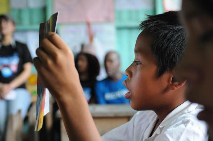A boy reads a textbook written in Shipibo, the local language, in the primary school in the indigenous Shipibo-Conibo community of Nuevo Saposoa, in the Peruvian Amazon.