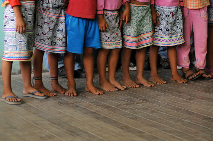Children stand inside their classroom in the indigenous Shipibo-Conibo community of Nuevo Saposoa in the Peruvian Amazon.