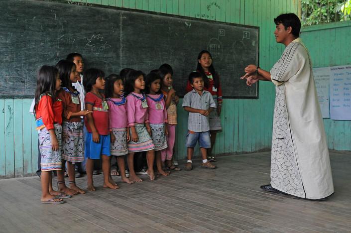 A teacher instructs students in the indigenous Shipibo-Conibo community of Nuevo Saposoa in the Peruvian Amazon.