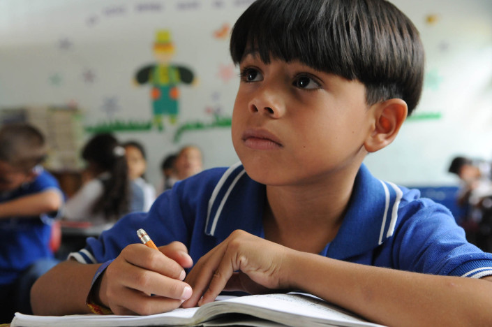 A boy studies during a second-grade Spanish class near Medellin, Colombia.
