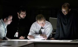 (L-R) Star-Ledger Photographers Aristede Economopoulos and Tony Kurdzuk discuss images with Star-Ledger Director of Photography Pim VanHemmen and Feature Photo Editor Lucius Riley over the photo department's light table. ©Amanda Brown/The Star-Ledger