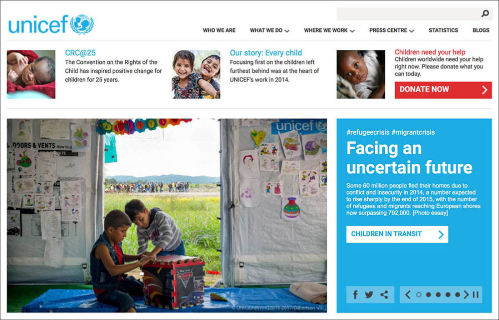 Screen capture of a web page photo of refugee boys playing at a transit centre for refugees and migrants, on unicef.org