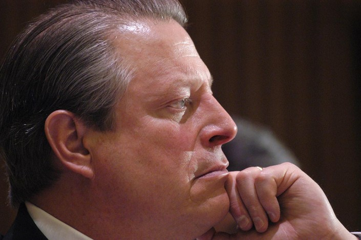 Al Gore looking serious while listening to a speaker at the UN.