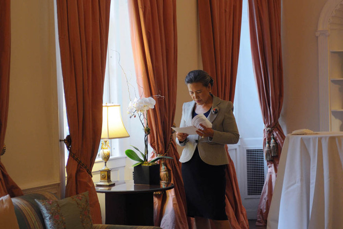 Portrait of Mrs. Ban Ki-moon reads next to a window in the elegant living room of the United Nations official residence.