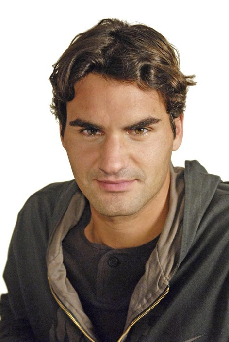 Tennis Ace Roger Federer poses for a portrait in a studio.