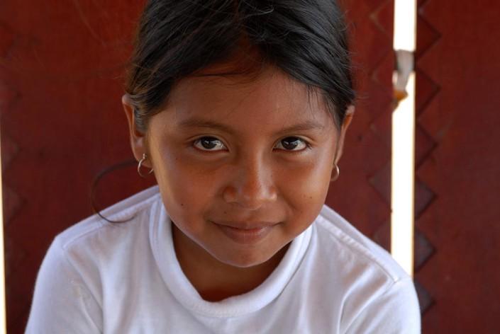 Close-up photograph of a 10-year-old indigenous Añu girl in Laguna de Sinamaica, Venezuela.