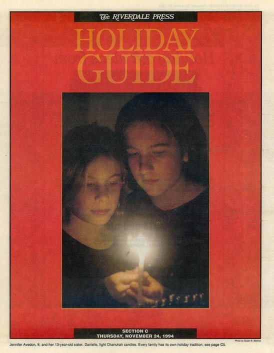 Tear sheet of sisters Danielle and Jenny lighting a menorah.