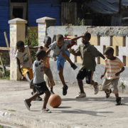 Boys play football on the street in the community of Trenchtown in the parish of Kingston and St. Andrew, Jamaica.