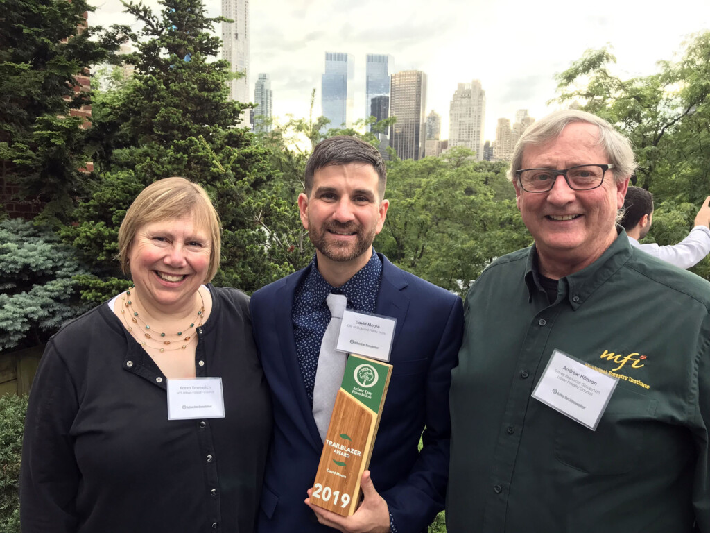 David Moore, center, at the ADF Trailblazer Award celebration in Central Park with current NYSUFC President Karen Emmerich and past NYSUFC President Andy Hillman.