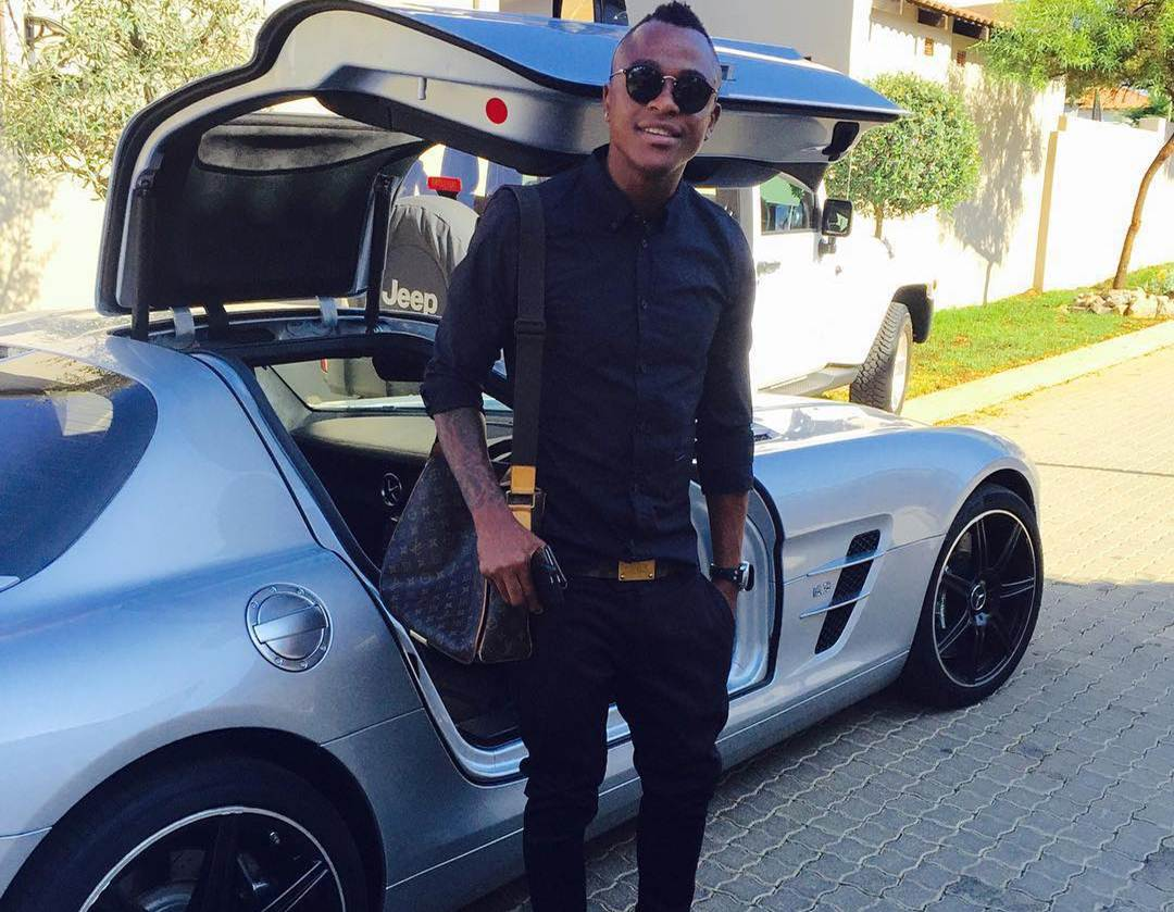 Photo of Tsepo Masilela and his hot Benz