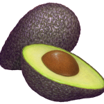 Ripe avocados with one whole and one cut half