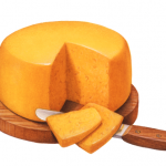 Cheddar cheese wheel on a wooden cutting board with a cheese knife and two cut cheese slices