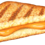 Cut grilled cheese sandwich with melted cheddar cheese.