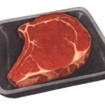 Uncooked beef rib steak on a black foam container.