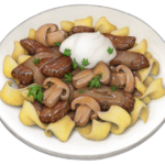 White plate of beef stroganoff.