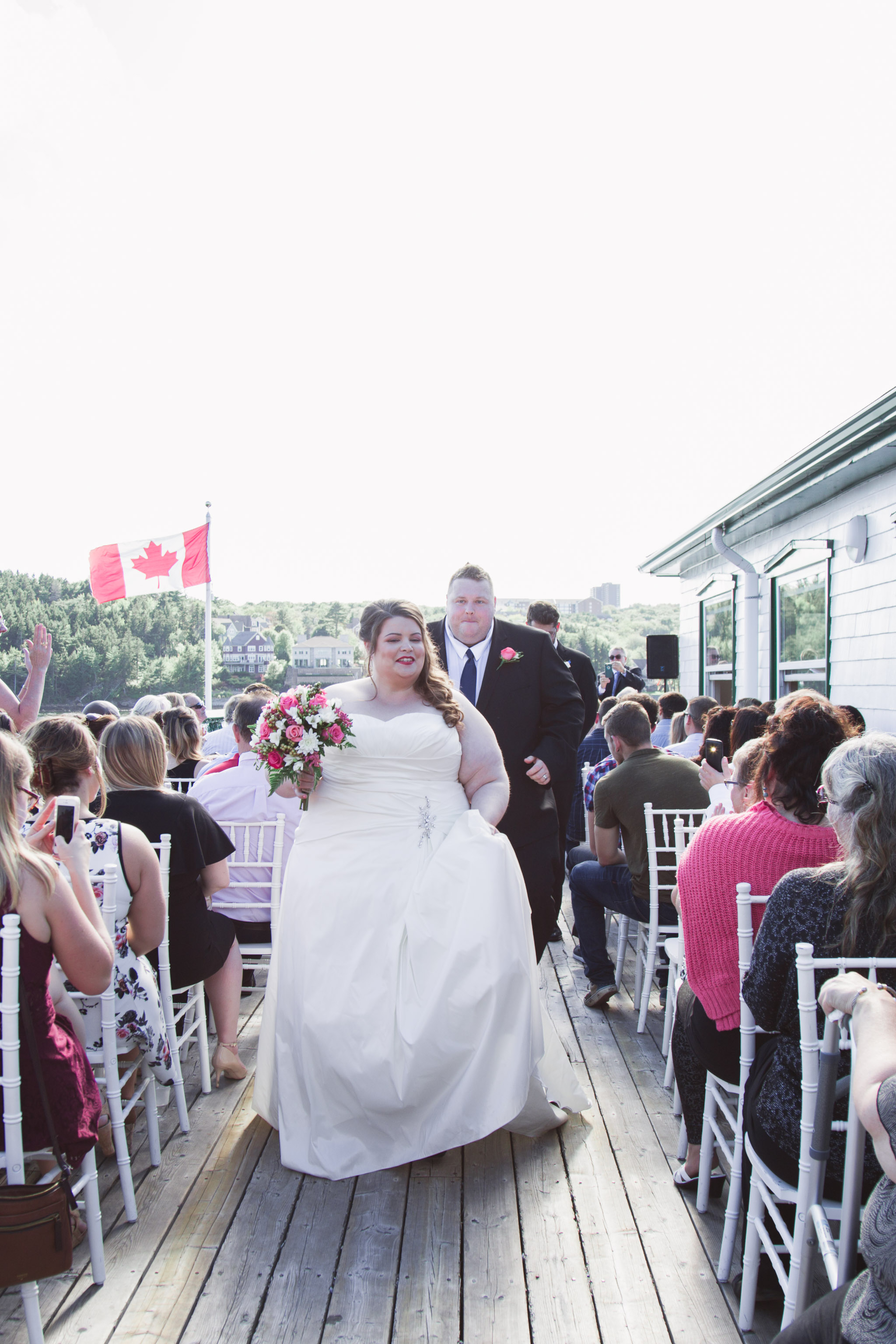Image of bride and groom walking down an isle