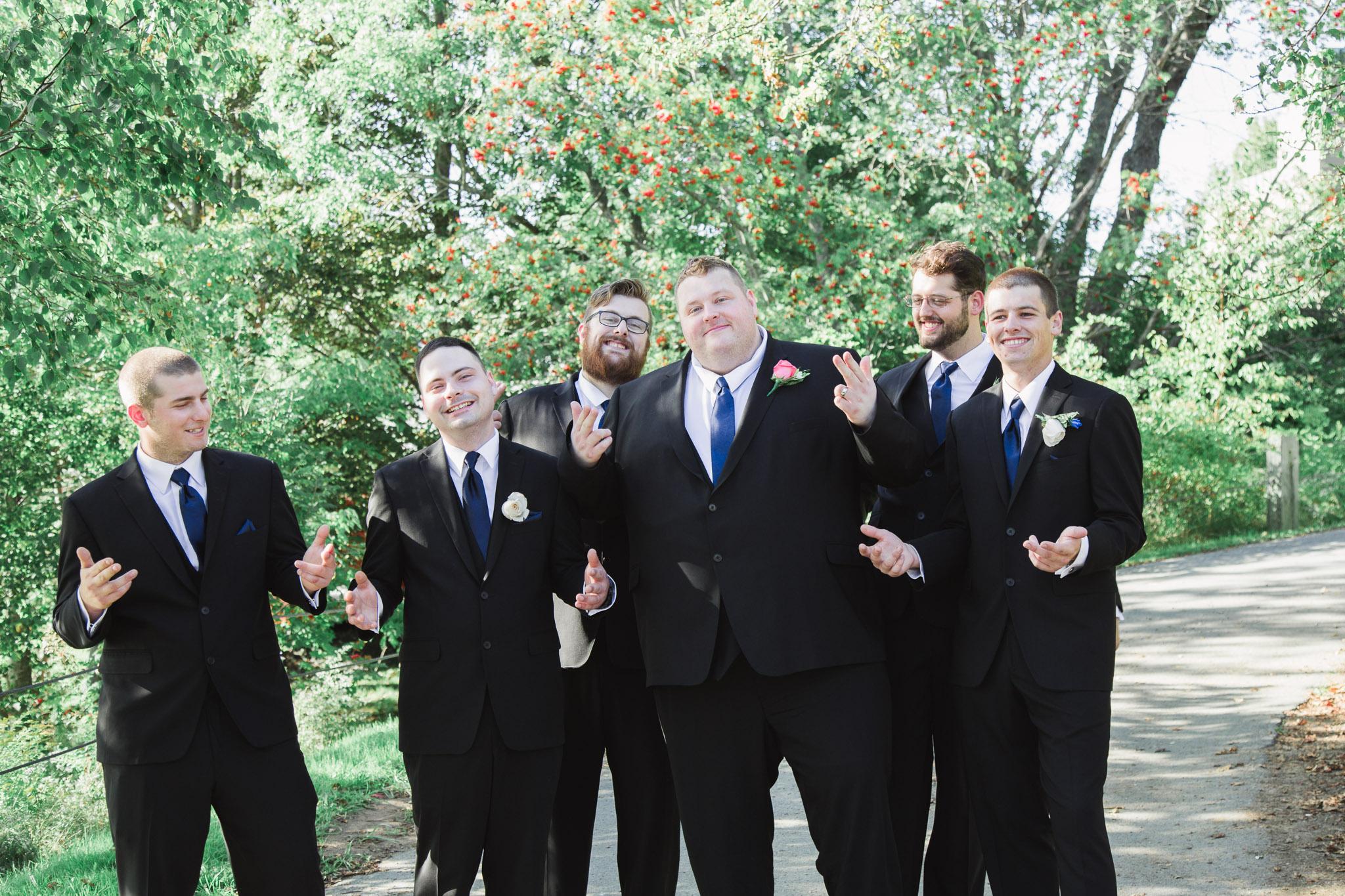 Image of groom posing with groomsmen