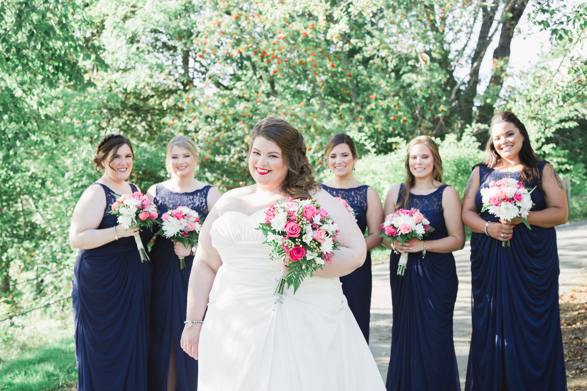 Image of bride posing with her bridesmaids at the background