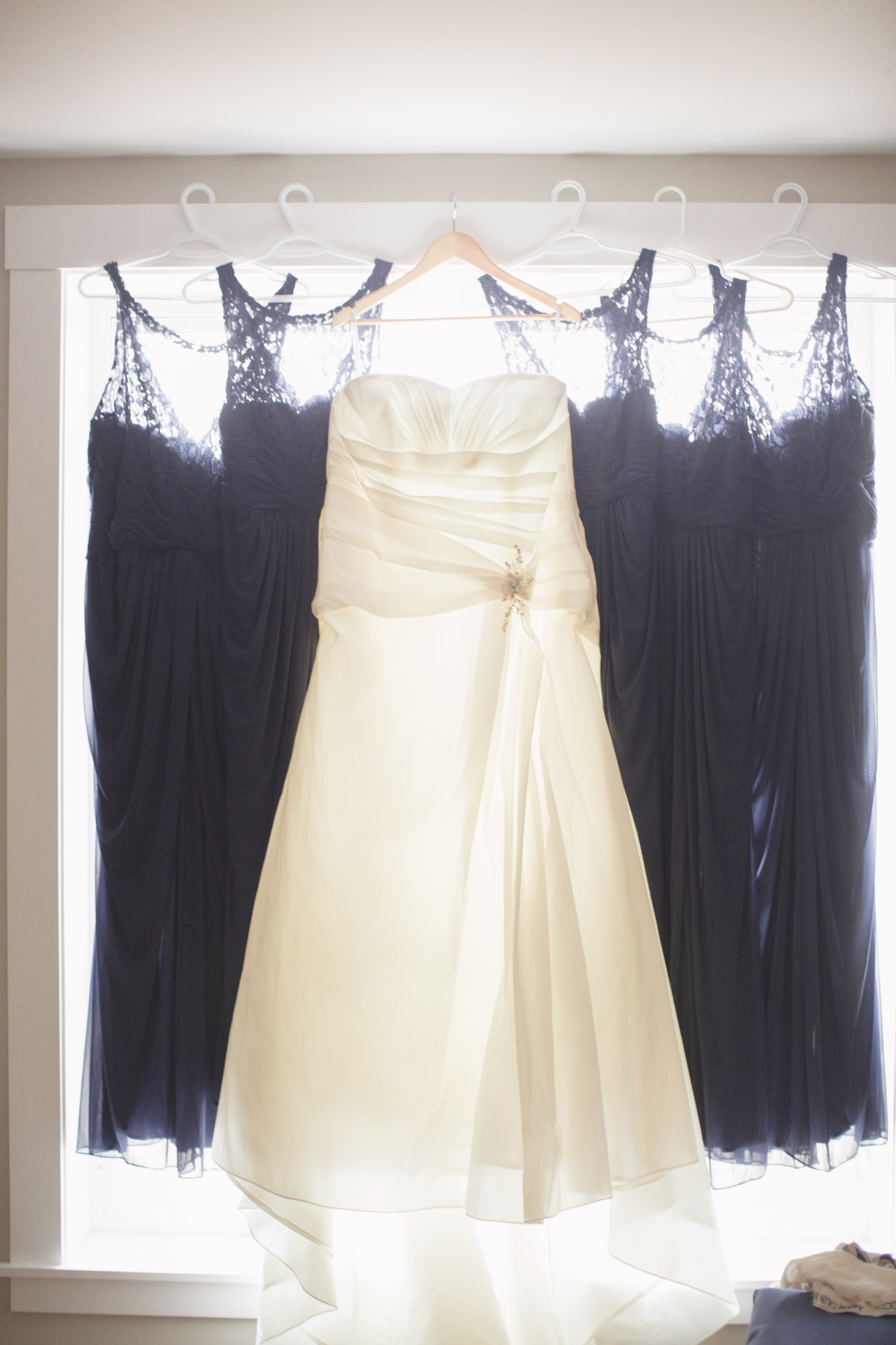 Image of one bridal dress and 5 blue bridesmaids dresses