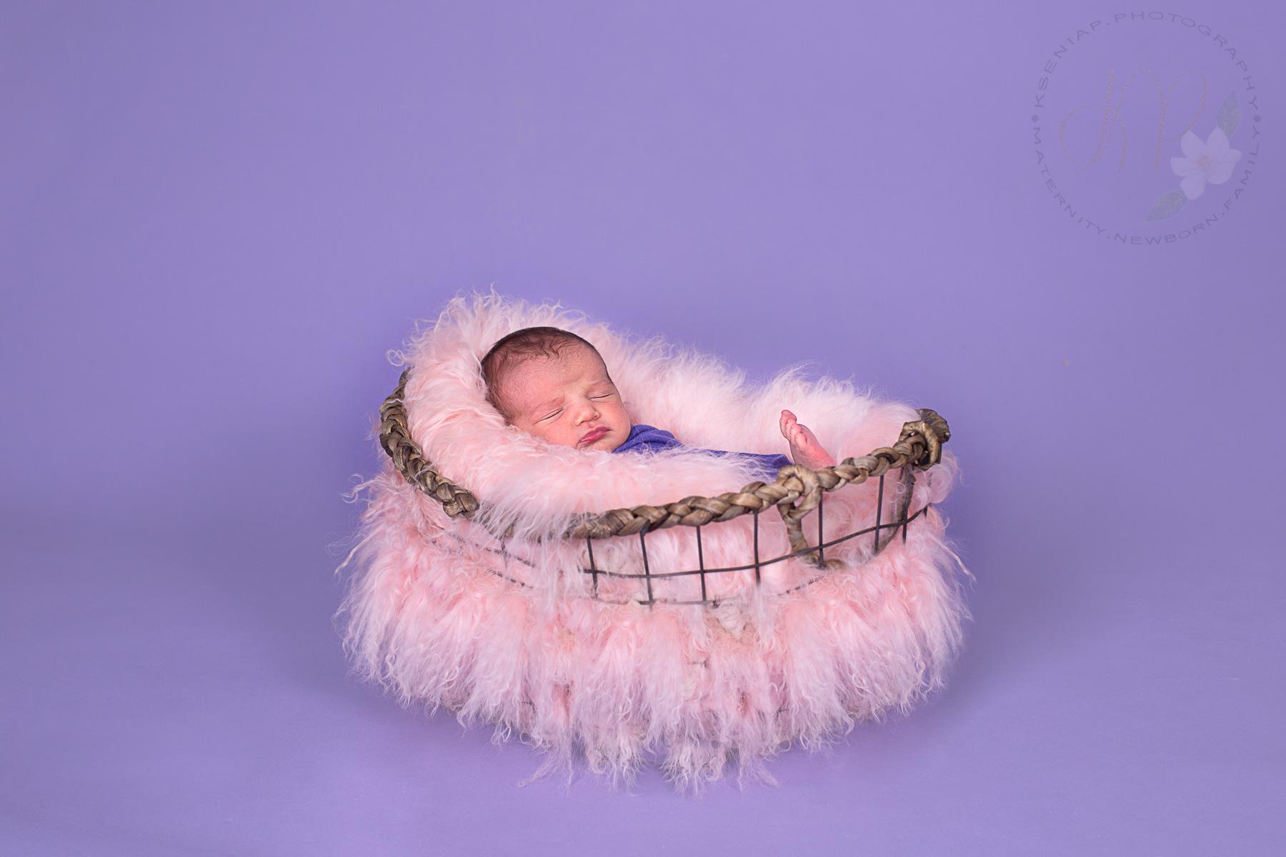 Image of baby sleeping in the basket
