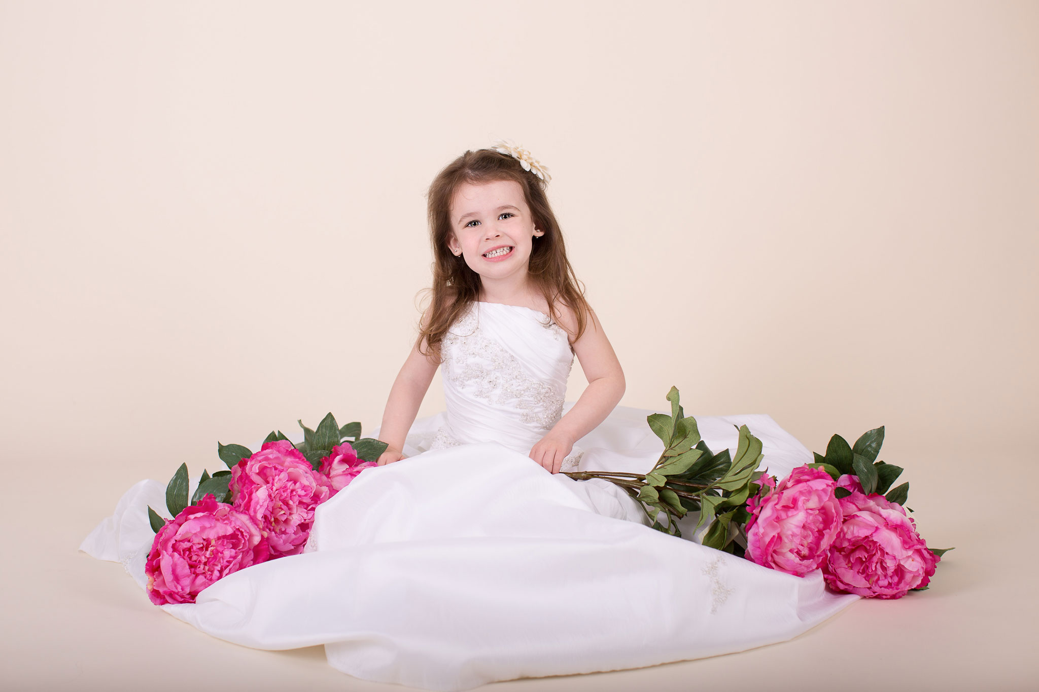 Girl posing in her mothers wedding dress